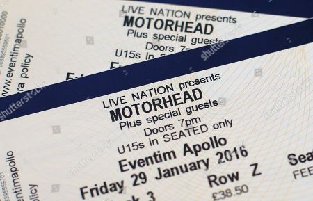 """Stock Picture of Two tickets for the upcoming concert for Motorhead are displayed, in London, . Ian """"Lemmy"""" Kilmister, the singer and bassist of Motorhead died Monday at age 70 after a brief battle with aggressive cancer, said his agent Andrew Goodfriend. Kilmister had learned of the diagnosis just two days earlier, according to a statement from the band, and he had also suffered several other health issues in recent months"""
