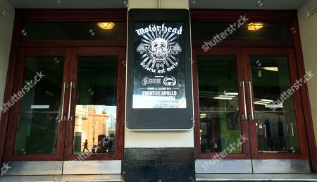 """An electronic poster showing an advert for an upcoming concert for Motorhead is displayed, outside a venue in London, . Ian """"Lemmy"""" Kilmister, the singer and bassist of Motorhead died Monday at age 70 after a brief battle with aggressive cancer, said his agent Andrew Goodfriend. Kilmister had learned of the diagnosis just two days earlier, according to a statement from the band, and he had also suffered several other health issues in recent months"""
