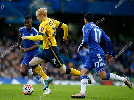 Scunthorpe United's Luke Williams, centre, gets past Chelsea's Ramires, left and Chelsea's Pedro during the English FA Cup third round soccer match between Chelsea and Scunthorpe United at Stamford Bridge stadium in London