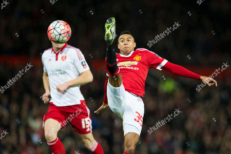 Manchester United's Jesse Lingard, right, fights for the ball against Sheffield United's Neill Collins during the English FA Cup third round soccer match between Manchester United and Sheffield United at Old Trafford Stadium, Manchester, England