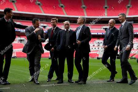 Former Chelsea manager Jose Mourinho, third right, jokes with, from left, former Spanish national team captain Fernando Hierro, former player Predrag Mijatovic of Montenegro, former Czech national team player Vladimir Smicer, former Brazilian national team player Roberto Carlos, Silvino Louro who has worked as goalkeeping coach for Mourinho, and former Italian national team goalkeeper Francesco Toldo as they attend a group photo session pitchside in support of FIFA Presidential Candidate Gianni Infantino after unveiling his 90 day plan that he will implement if he is elected FIFA President, at Wembley Stadium in London