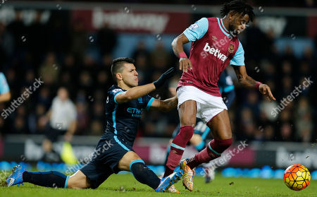 West Ham United's Alex Song, right takes the ball away from Manchester City's Sergio Aguero who slips during the English Premier League soccer match between West Ham United and Manchester City at the Boleyn Ground in London