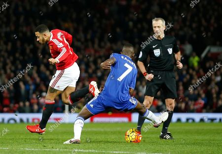 Manchester United's Memphis Depay, left, flicks the ball as Chelsea's Ramires challenges during the English Premier League soccer match between Manchester United and Chelsea at Old Trafford Stadium, Manchester, England
