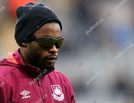 West Ham United's Alex Song is seen wearing his protective glasses during his warm up ahead of the English Premier League soccer match between Newcastle United and West Ham United at St James' Park, Newcastle, England