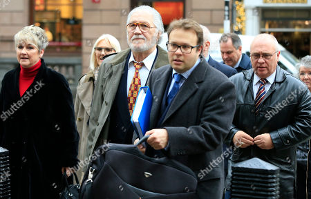 Stock Picture of Former British radio DJ Dave Lee Travis, center, arrives at the Royal Courts of Justice with his legal team in London, . Travis lost his appeal against a conviction for indecent assault at the court Tuesday