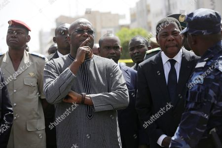 Stock Image of Burkina Faso President, Roch Marc Christian Kabore, left, and Benin President, Thomas Boni Yayi, right, visit the Splendid Hotel that was attacked in Ouagadougou, Burkina Faso, . Burkina Faso began three days of national mourning Sunday and the president said security would be stepped up in the capital and the country's borders after al-Qaida militants carried out an attack on a hotel and cafe popular with foreigners