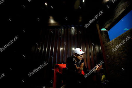 Cui Jian Veteran Chinese rock star Cui Jian gestures while speaking during an interview in Beijing. China's Godfather of rock Cui said his message of personal freedom hasn't changed in his new album, even if the world has