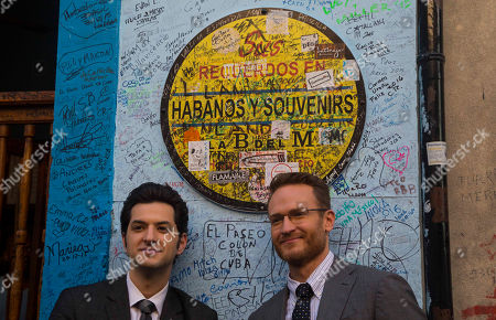 """House of Lies"""" actors Ben Schwartz and Josh Lawson, right, pose outside the Bodeguita Del Medio bar during a shoot of an episode in Havana, Cuba. The producers of Showtime's dark comedy """"House of Lies"""" had $3 million and a mission: shoot the first episode of scripted American television in Cuba in more than half a century"""