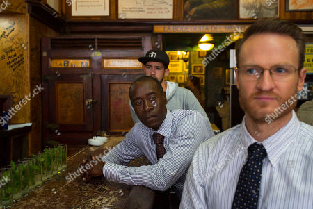 """Josh Lawson, Don Cheadle House of Lies"""" actors Don Cheadle and Josh Lawson, right, sit at the bar counter in Bodeguita Del Medio during the filming of an episode, in Havana, Cuba. The producers of Showtime's dark comedy """"House of Lies"""" had $3 million and a mission: shoot the first episode of scripted American television in Cuba in more than half a century"""