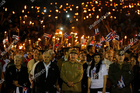 Raul Castro, Jose Mujica Cuba´s President Raul Castro, center front, along with Uruguay's former President Jose Mujica, his wife Sen. Lucia Topolansky, left, President of University Students Federation Jennifer Bello and Revolutionionary Commander Ramiro Valdes, front right, take part in a march with torches in a procession, marking the 163rd anniversary of the birth of Cuba's national independence hero Jose Marti, in Havana, Cuba