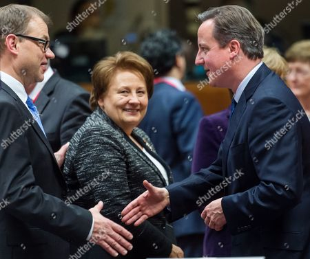 David Cameron, Juha Sipila, Laimdota Straujuma Britain's Prime Minister David Cameron, right, greets Finland's Prime Minister Juha Sipila as Latvian Prime Minister Laimdota Straujuma walks by during an EU summit in Brussels on . European Union heads of state meet Thursday to discuss, among other issues, the current migration crisis and terrorism