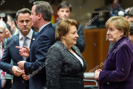 Stock Picture of Xavier Bettel, David Cameron, Angela Merkel, Laimdota Straujuma German Chancellor Angela Merkel, right, talks with Latvian Prime Minister Laimdota Straujuma, 2nd right, as British Prime Minister David Cameron, 2nd left, talks with Luxembourg's Prime Minister Xavier Bettel during an EU summit in Brussels on . European Union heads of state meet Thursday to discuss, among other issues, the current migration crisis and terrorism
