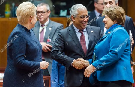 Stock Photo of Portuguese Prime Minister Antonio Costa, center, speaks with Latvian Prime Minister Laimdota Straujuma, right, and Lithuanian President Dalia Grybauskaite during a round table meeting an EU summit in Brussels on . European Union leaders are reconvening in Brussels for the final day of their year-end summit with a wide-ranging agenda including how to build greater economic unity among their 28 countries and stepping up the fight against terrorism