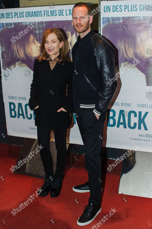 French Actress Isabelle Huppert, left and Danish director Joachim Trier pose for the media as they arrive for the French premiere of 'Back Home' in Paris