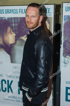 Danish director Joachim Trier poses for the media as he arrives for the French premiere of 'Back Home' in Paris