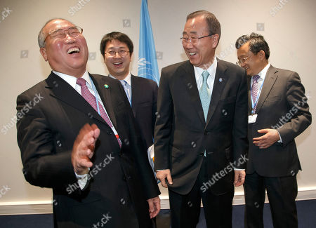 China's Special Representative on Climate Change Xie Zhenhua, left, laughs as he walks into the conference room with United Nations Secretary General Ban Ki-moon for bilateral talks during the COP21, United Nations Climate Change Conference, in Le Bourget, north of Paris, . French Foreign Minister Laurent Fabius says high-stakes climate talks he is co-hosting outside Paris will not end Friday as planned but will last at least until Saturday. Background from left, an unidentified translator and China's vice foreign minister Liu Zhenmin
