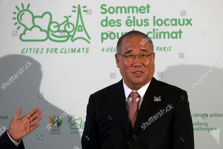 "Chinese Vice Chairman National Development and Reform Commission, Xie Zhenhua arrives for a press conference during a meeting with Mayors to push for local actions to fight climate change at Paris city Hall on the margins of the COP21, United Nations Climate Change Conference, in Paris, . The French president Francois Hollande said that ""no region in the world could feel protected of climate disorders"" and encouraged city mayors to get involved in fighting climate change"