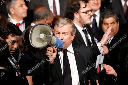 French businessman Richard Attias tries to organize using a megaphone a group picture along with mayors from various cities during a meeting with Mayors at Paris city Hall as part of the COP21, United Nations Climate Change Conference, in Paris