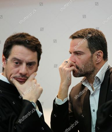 Jerome Kerviel, right, and his lawyer David Koubbi wait inside the Versailles appeal court, outside Paris, . Jerome Kerviel, convicted of the trading fraud that nearly brought down the French bank Societe Generale, is back in court to fight the 4.9 billion euros ($5.34 billion) in damages he had been ordered to pay for his ex-employer's losses