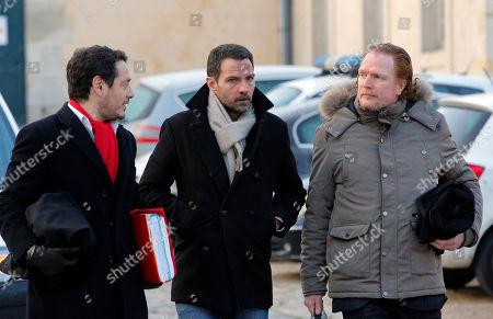 Jerome Kerviel, center, his lawyers David Koubbi, left, and Benoît Pruvost arrive at the Versailles appeal court, outside Paris, . Jerome Kerviel, convicted of the trading fraud that nearly brought down the French bank Societe Generale, is back in court to fight the 4.9 billion euros ($5.34 billion) in damages he had been ordered to pay for his ex-employer's losses
