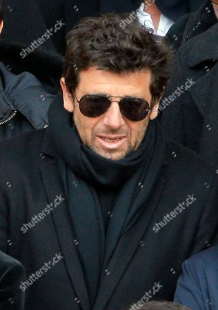 French actor Patrick Bruel leaves the Saint-Sulpice church after the funeral ceremony of late French singer Michel Delpech in Paris