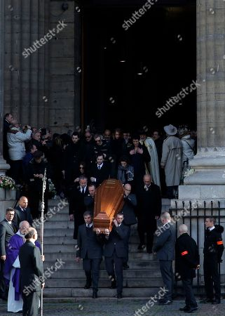 The coffin of late French singer, songwriter and actor, Michel Delpech is carried after his funeral ceremony at the Saint-Sulpice church in Paris
