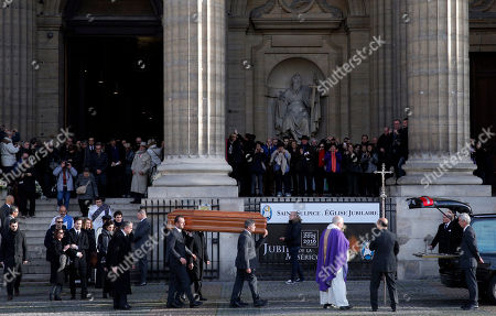 The coffin of late French singer, songwriter an actor, Michel Delpech is carried after his funeral ceremony at the Saint-Sulpice church in Paris