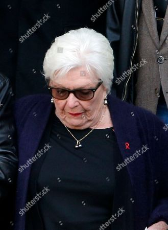 French singer Line Renaud leaves the Saint-Sulpice church after the funeral ceremony of late French singer Michel Delpech, in Paris