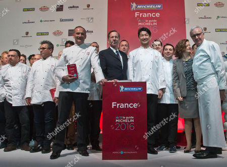Stock Picture of French Chef Christian Le Squer, 3rd left, and French Chef Alain Ducasse, right, pose for the media among 1 and 2 stars chefs after the Michelin Guide 2016 award ceremony in Paris, . French Chef Alain Ducasse with his restaurant in Paris' Plaza Athenee and French Chef Christian Le Squer with his restaurant Le Cinq in Paris were newly awarded with the prestigious 3 stars this year