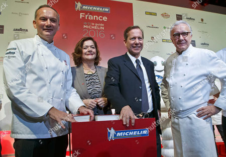 Stock Picture of From left, French Chef Christian Le Squer, Executive Vice President Brands and External Relations of Michelin Claire Dorland-Clauzel, Worldwide Michelin Guide Director Michael Ellis and French Chef Alain Ducasse pose for the media after the Michelin Guide 2016 award ceremony in Paris, . French Chef Alain Ducasse with his restaurant in Paris' Plaza Athenee and French Chef Christian Le Squer with his restaurant Le Cinq in Paris were newly awarded with the prestigious 3 stars this year
