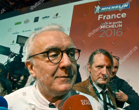 Stock Photo of French Chef Alain Ducasse speaks to the media after the Michelin Guide 2016 award ceremony in Paris, . French Chef Alain Ducasse with his restaurant in Paris' Plaza Athenee and French Chef Christian Le Squer with his restaurant Le Cinq in Paris were newly awarded with the prestigious 3 stars this year