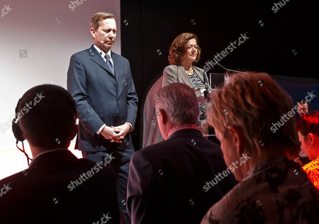 Stock Picture of Worldwide Michelin Guide Director Michael Ellis, left, and Executive Vice President Brands and External Relations of Michelin Claire Dorland-Clauzel observe a minute of silence for French Swiss Chef Benoit Violier during the Michelin Guide 2016 awards ceremony in Paris, . Swiss police say 3-star chef Benoit Violier, whose restaurant near Lausanne recently topped a list of the world's best, has been found dead of an apparent self-inflicted gunshot