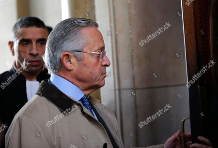 International art dealer Guy Wildenstein arrives at a Paris courtroom, Monday Jan.4, 2016. Wildenstein is going on trial on charges of defrauding the French state of half a billion euros (about $550 million) in taxes, after two relatives tipped off authorities about the family's financial dealings. Wildenstein, 70, Franco-American heir of a New York art-dealing empire, is accused of concealing much of his inherited fortune in trusts held in offshore tax havens