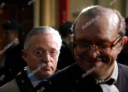International art dealer Guy Wildenstein leaves a Paris courtroom with his lawyer Herve Temime, right, Monday Jan.4, 2016. Wildenstein is going on trial on charges of defrauding the French state of half a billion euros (about $550 million) in taxes, after two relatives tipped off authorities about the family's financial dealings. Wildenstein, 70, Franco-American heir of a New York art-dealing empire, is accused of concealing much of his inherited fortune in trusts held in offshore tax havens