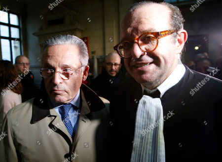 International art dealer Guy Wildenstein, center, leaves a Paris courtroom with his lawyer Herve Temime, right, Monday Jan.4, 2016. Wildenstein is going on trial on charges of defrauding the French state of half a billion euros (about $550 million) in taxes, after two relatives tipped off authorities about the family's financial dealings. Wildenstein, 70, Franco-American heir of a New York art-dealing empire, is accused of concealing much of his inherited fortune in trusts held in offshore tax havens