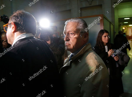 International art dealer Guy Wildenstein, center, leaves a Paris courtroom with his lawyer Herve Temime, left, Monday Jan.4, 2016. Wildenstein is going on trial on charges of defrauding the French state of half a billion euros (about $550 million) in taxes, after two relatives tipped off authorities about the family's financial dealings. Wildenstein, 70, Franco-American heir of a New York art-dealing empire, is accused of concealing much of his inherited fortune in trusts held in offshore tax havens