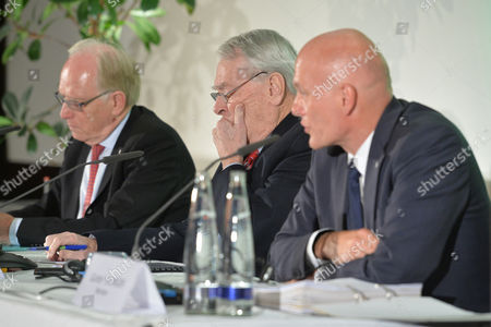 Legal Counsel Richard McLaren, Richard W. Pound, Wada Founding President and former IOC Vice President, and Guenter Younger, Head f Departmen f Cybercrime with the Bavarian Landeskriminalamt, from left, attend a press conference about WADA's Independet Commission Report in Munich, Germany, on