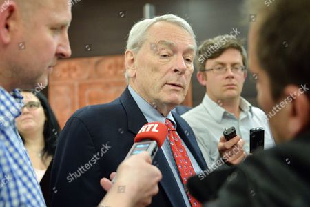 Canadian Richard Pound, center,Chairman of WADA's (World Anti-Doping Agency) Independent Commission (IC), answers questions after he presented the findings of his Commission's Report surrounding allegations of doping in sport, during a press conference in Munich, Germany, on