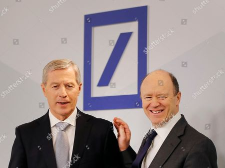 Co-CEOs of Deutsche Bank John Cryan, right, and Juergen Fitschen stand together prior to the annual press conference in Frankfurt, Germany
