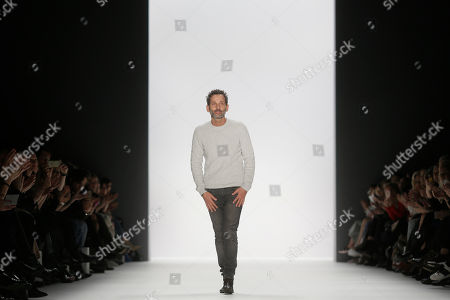 Stock Image of Designer Dimitrios Panagiotopoulos of fashion label Dimitri receives applause after his fashion show during the Fashion Week in Berlin, Germany