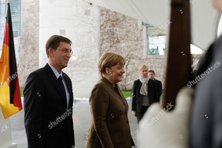 German Chancellor Angela Merkel, right, welcomes the Prime Minister of Slovenia Miroslav Cerar for talks at the chancellery in Berlin, Germany