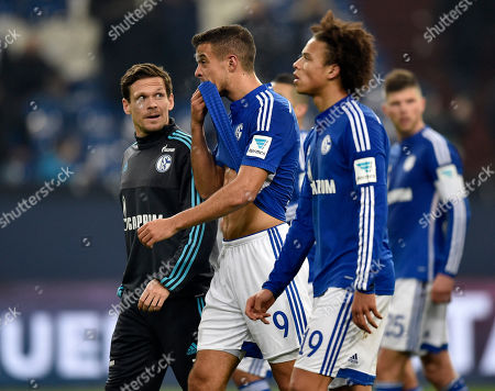 Schalke's Sascha Riether, Franco di Santo and Leroy Sane, from left, leave the pitch disappointed after losing the German Bundesliga soccer match between FC Schalke 04 and Werder Bremen in Gelsenkirchen, Germany, . Schalke was defeated by Bremen with 1-3