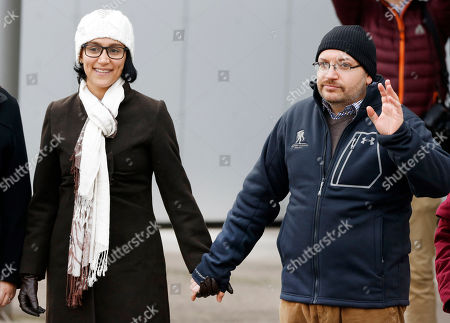 U.S. journalist Jason Rezaian and his wife Yeganeh Salehi hold hands as they pose for media people in front of Landstuhl Regional Medical Center in Landstuhl, Germany, . Rezaian was released from an Irani prison last Saturday