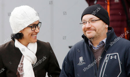 U.S. journalist Jason Rezaian and his wife Yeganeh Salehi look at each others as they pose for media people in front of Landstuhl Regional Medical Center in Landstuhl, Germany, . Rezaian was released from an Irani prison last Saturday