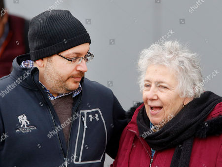 U.S. journalist Jason Rezaian, left, talks to his mother Mary Rezaian as he poses for media people in front of Landstuhl Regional Medical Center in Landstuhl, Germany, . Rezaian was released from an Irani prison last Saturday