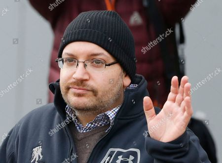U.S. journalist Jason Rezaian waves as he poses for media people in front of Landstuhl Regional Medical Center in Landstuhl, Germany, . Rezaian was released from an Irani prison last Saturday