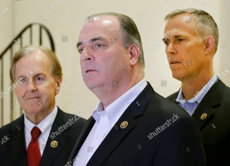 U.S. Representatives Robert Pittenger, left, Dan Kildee, center, and Jared Huffman, right, talk to media people at the Landstuhl Regional Medical Center in Landstuhl, Germany, . Four U.S. citizens who were released from an Iranian prison where transferred to Landstuhl for medical treatment