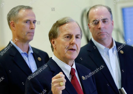 U.S. Representatives Robert Pittenger, center, Dan Kildee, right, and Jared Huffman, left, talk to media people at the Landstuhl Regional Medical Center in Landstuhl, Germany, . Four U.S. citizens who were released from an Irani prison where transferred to Landstuhl for medical treatment