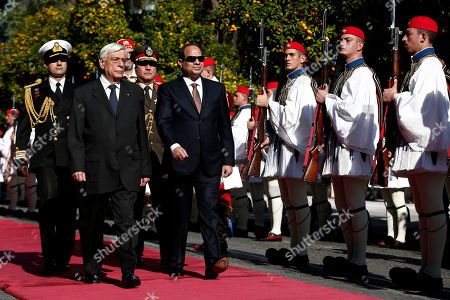Egyptian President Abdel Fattah el-Sissi, center, is escorted by Greek President Karolos Papoulias as they inspect a guard of honour outside the Presidential palace in Athens, on . Egyptian President Abdel Fattah el-Sissi is in Athens for a two-day visit that will focus on energy and shipping, as financially troubled Greece seeks economic cooperation with regional partners