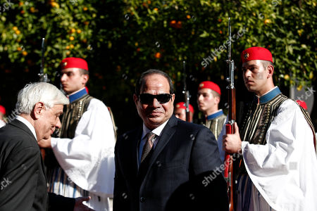 Egyptian President Abdel Fattah el-Sissi, center, is escorted by Greek President Karolos Papoulias, left, as they inspect a guard of honour outside the Presidential palace in Athens, on . Egyptian President Abdel Fattah el-Sissi is in Athens for a two-day visit that will focus on energy and shipping, as financially troubled Greece seeks economic cooperation with regional partners
